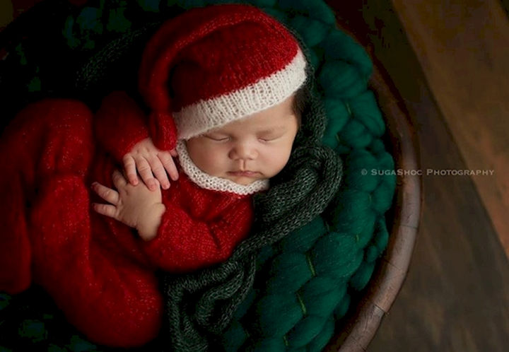 13 Cute Babies Wearing Christmas Outfits - An adorable sleepy Santa.