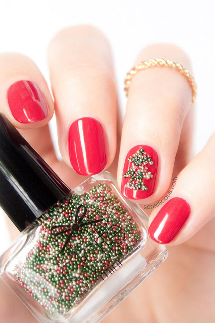 23 Christmas Nails - These glossy nails look great with a beaded Christmas tree accent nail.