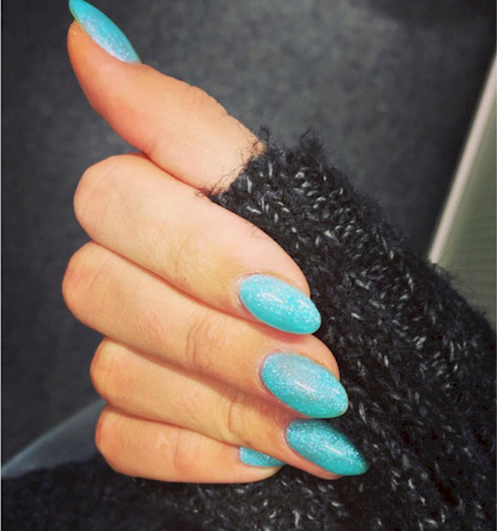18 Ice Blue Nails - A cool shade of icy blue with glitter accents.