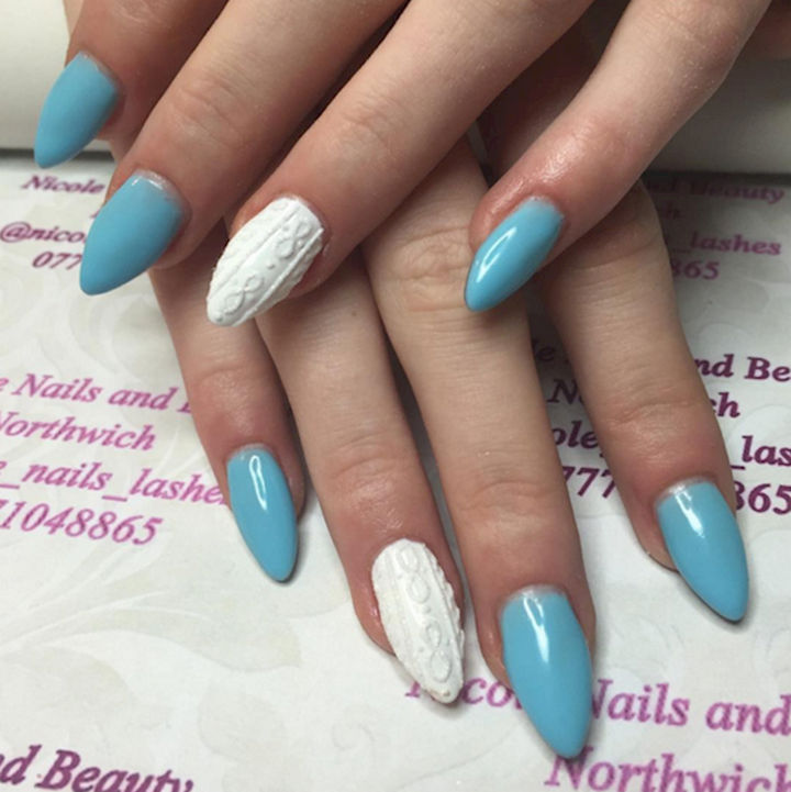 18 Ice Blue Nails - Knitted sweater accent nails complement icy blue lacquered nails.