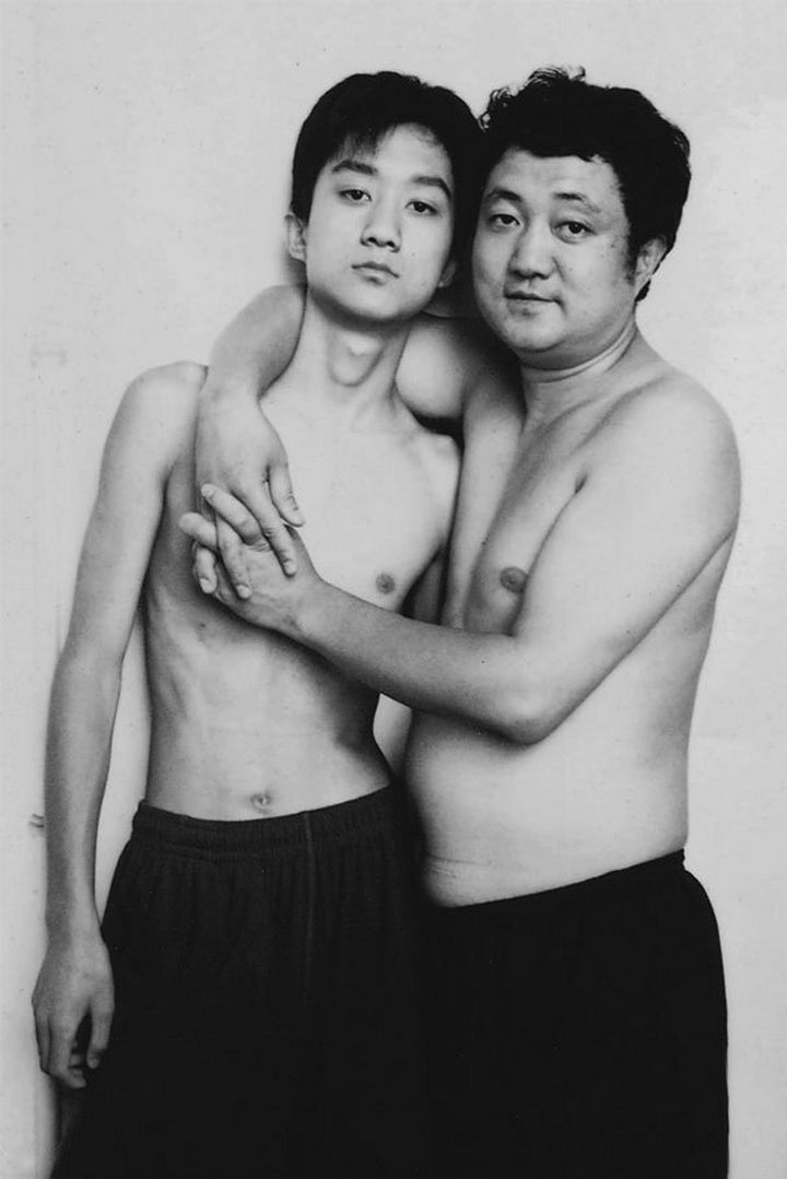 Father takes photo with his son every year. This one was taken in 2002.