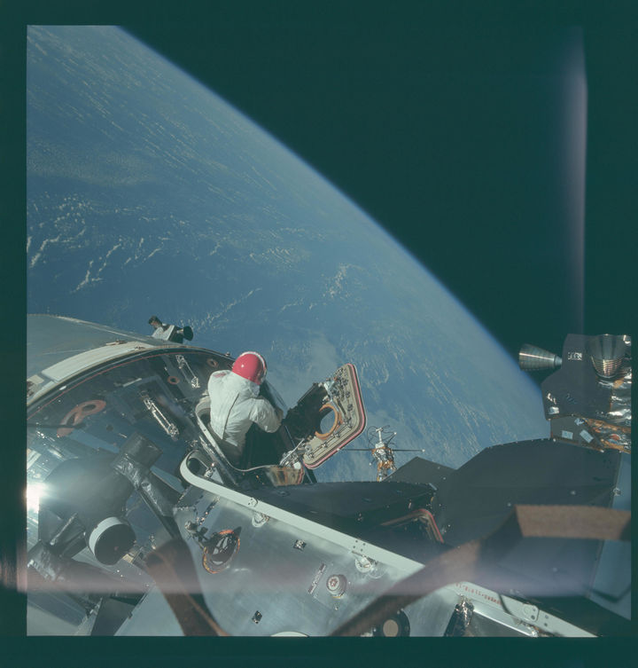35 Rare Historical Photos - 1969: Astronaut David Scott taking in the incredible view from space during an EVA from Command Module Gumdrop.