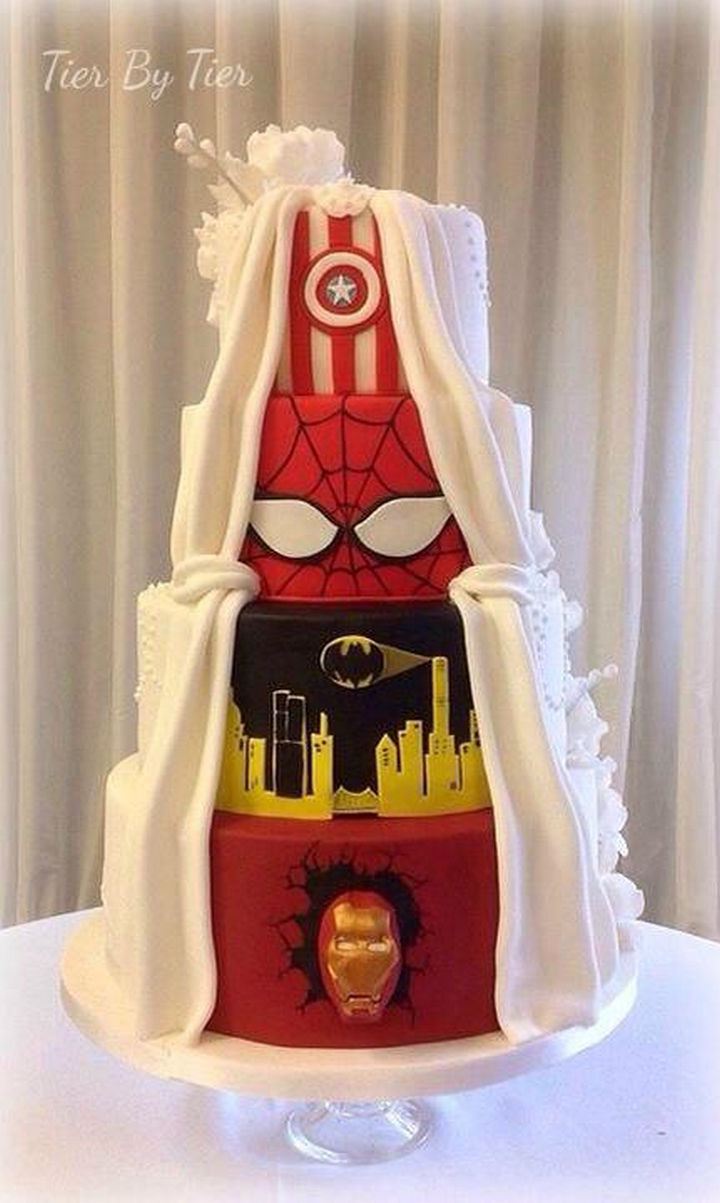 12 Him and Her Wedding Cake Ideas - Relationships are about compromise and this cake is traditional but also shares their love of comic book heroes.