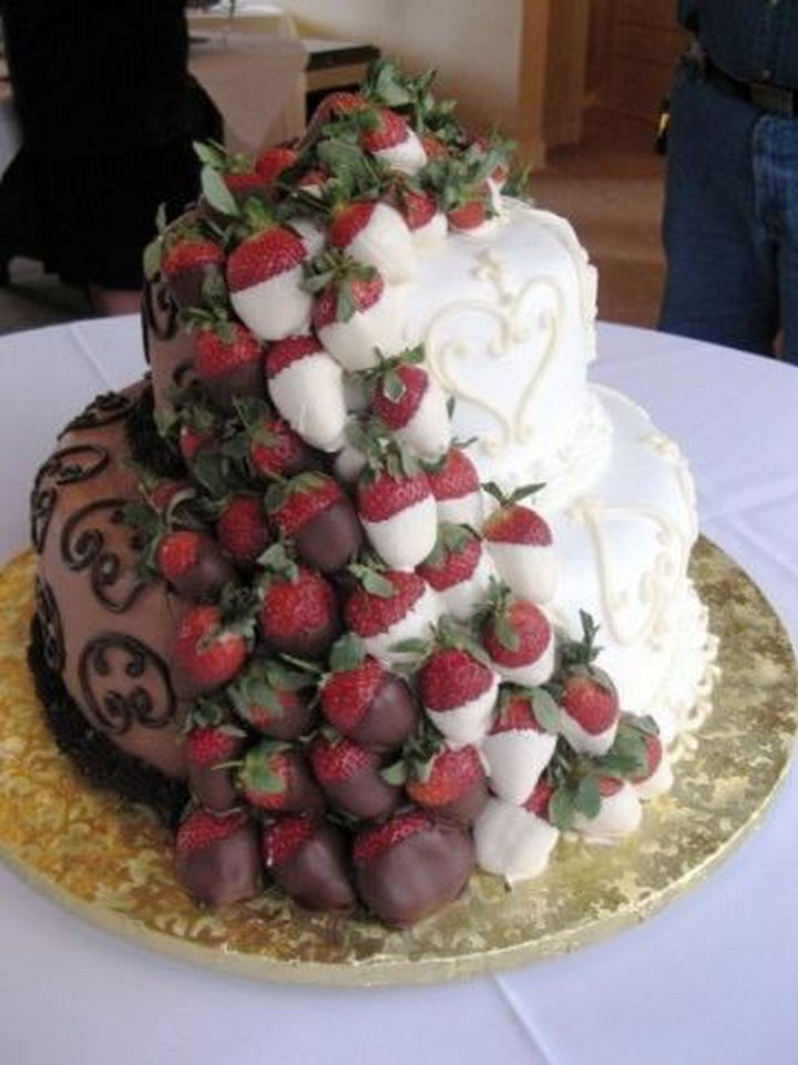 12 Him and Her Wedding Cake Ideas - Chocolate and vanilla with a cascade of chocolate-covered strawberries.