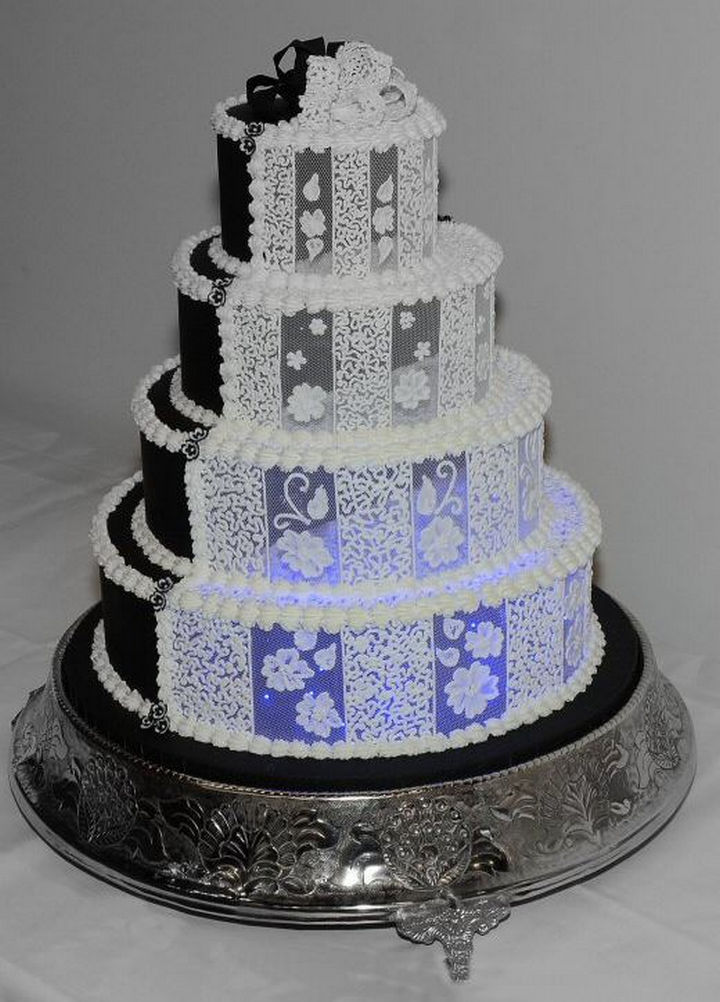 12 Him and Her Wedding Cake Ideas - A gorgeous wedding cake with intricate lace patterns. It is even illuminated with blue LED's!