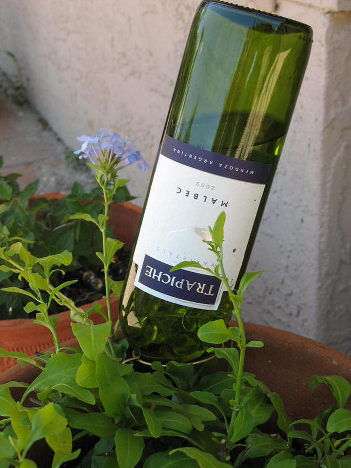 14 DIY Gardening Tips & Projects - Turn a wine bottle into a DIY self-watering bottle for your garden.
