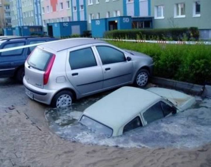 19 People Having a Bad Day - He probably wasn't expecting to park into a sink hole.