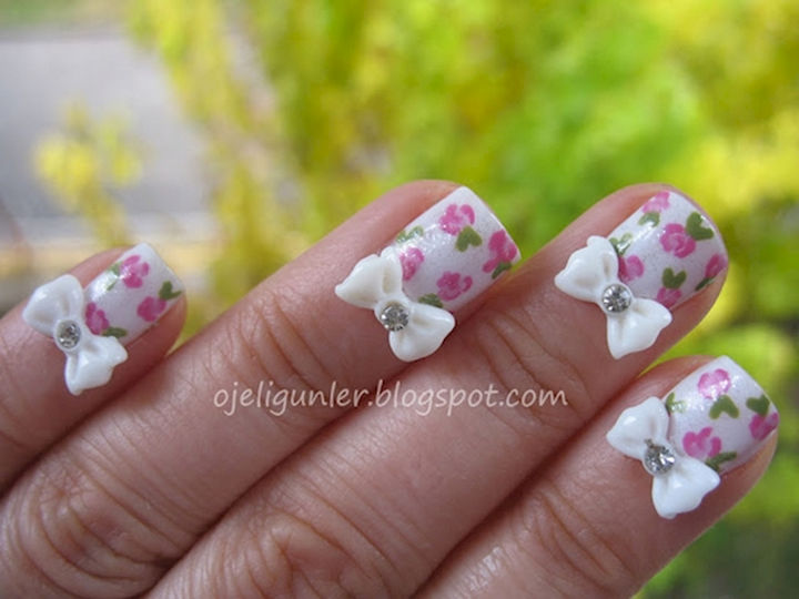 17 Bow Nail Art Designs - These floral nails are pretty but adding a bow finishes it off nicely.
