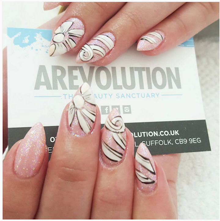 17 Bow Nail Art Designs - Gorgeous bow nails stretches across multiple nails.