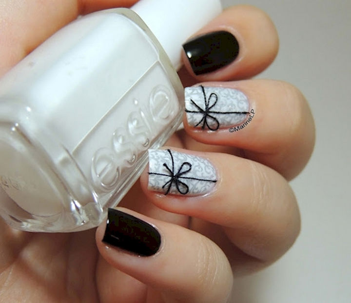 17 Bow Nail Art Designs - This bow nail art design uses real thread to create a bow and the effect is jaw-dropping.