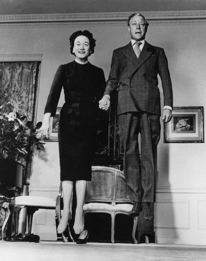 22 Timeless Images - Playful photo of The Duke and Duchess of Windsor captured while jumping together (1958).