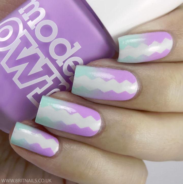 17 Gradient Nails - Pastel gradient with a striking chevron pattern.