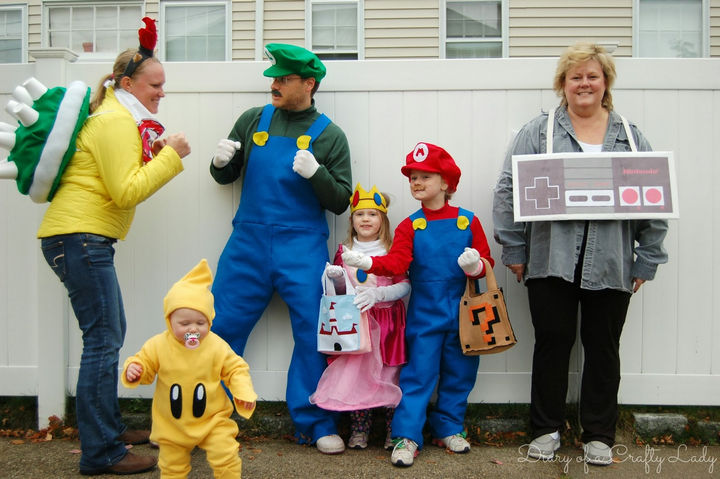 23 Super Mario and Luigi Costumes - The whole family gets in on the Super Mario fun including Grandma cleverly dressed as an NES controller. Awesome!