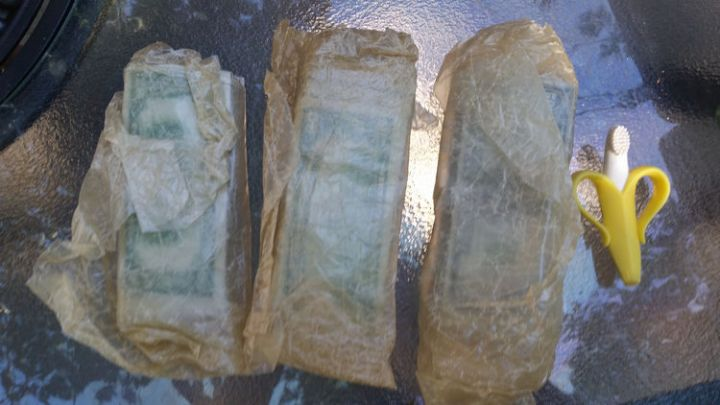 He pulled out three other packages wrapped in wax paper and the contents almost appear green!