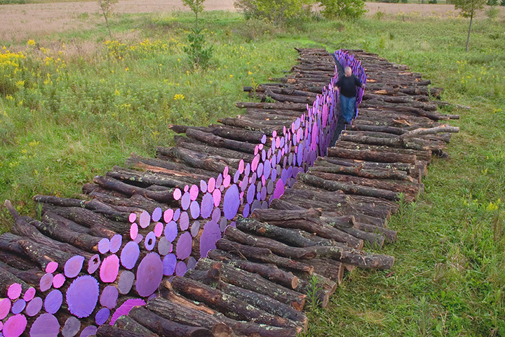 13 Displays of Stacked Wood Art - A colorful trench of pastel colors.