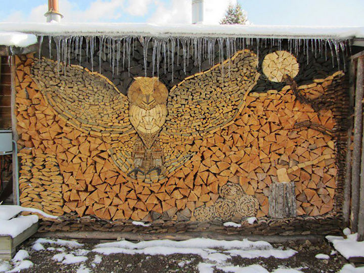 13 Displays of Stacked Wood Art - A majestic owl on a moonlit sky. The attention to detail is spectacular.
