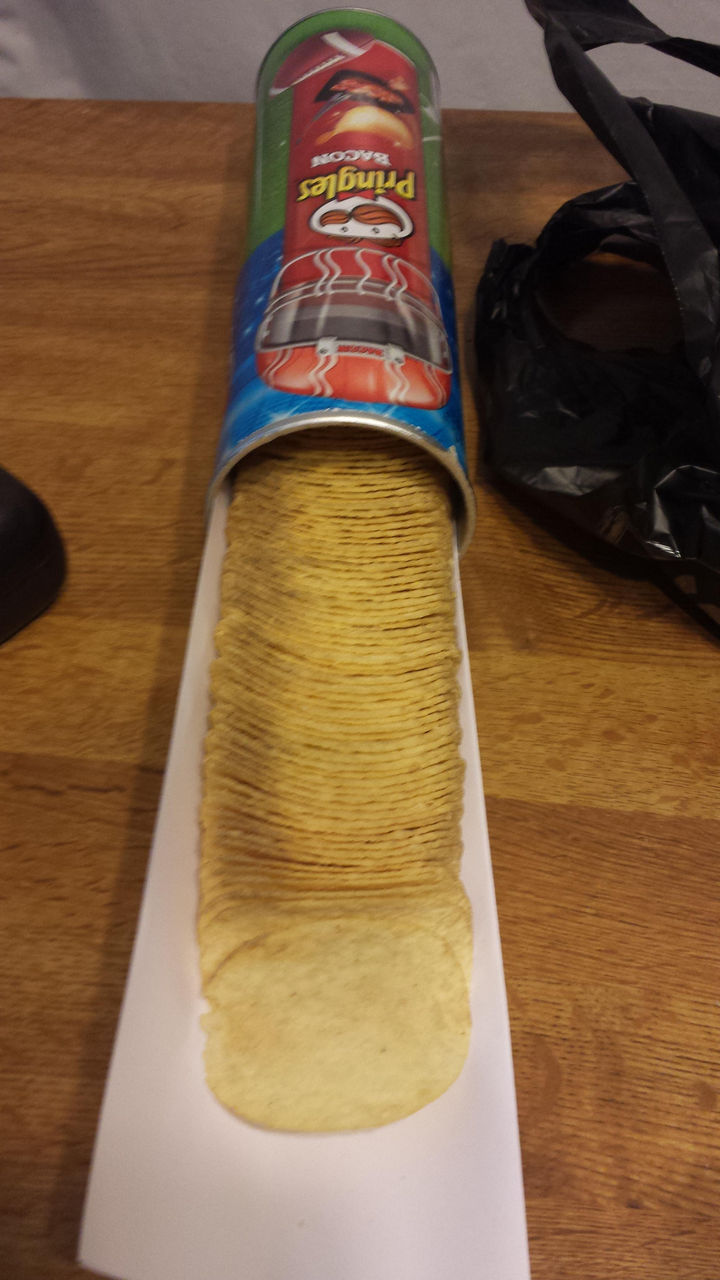 21 Everyday Life Hacks - Easily serve Pringles by using a piece of paper as a serving tray.
