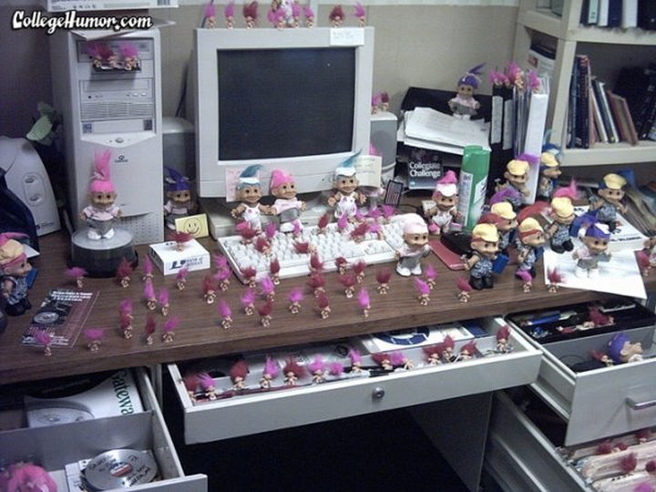 26 Funny Office Pranks - Who wouldn't like a desk full of Trolls.