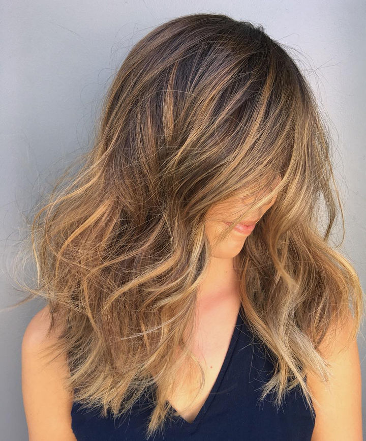 14 Lazy Girl Hair Hacks - Use dry shampoo at bedtime to wake up to super voluminous hair in the morning.