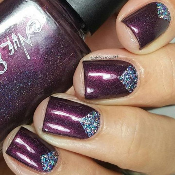 Edgy purple nails with just the right amount of glitter.