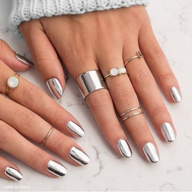 17 Chrome Nails - Silver chrome nails with some bling.