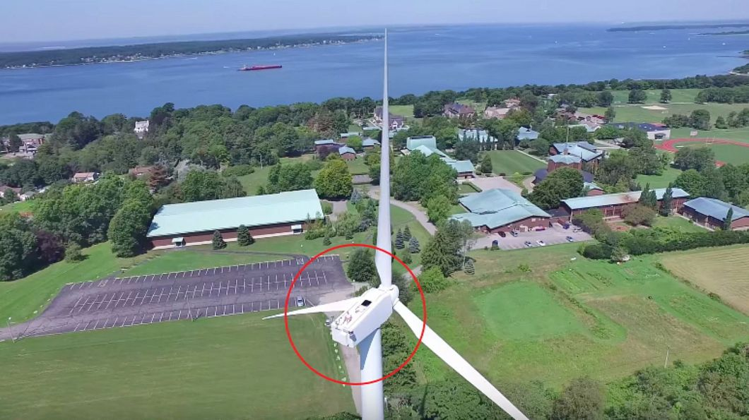 Drone Captures Man Sunbathing on a Wind Turbine.