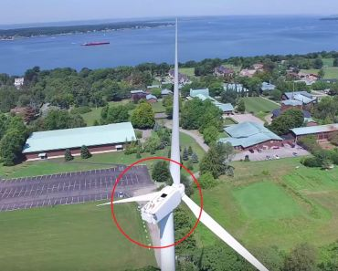 Drone Captures Man Sunbathing on a Wind Turbine.