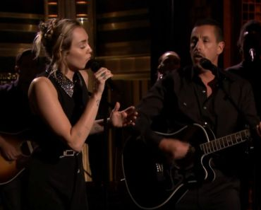 "Miley Cyrus and Adam Sandler's Moving Performance of ""No Freedom."""