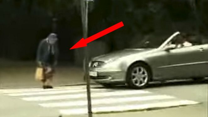 Elderly woman hits a car with her purse and gets her revenge at rude man honking his car horn.