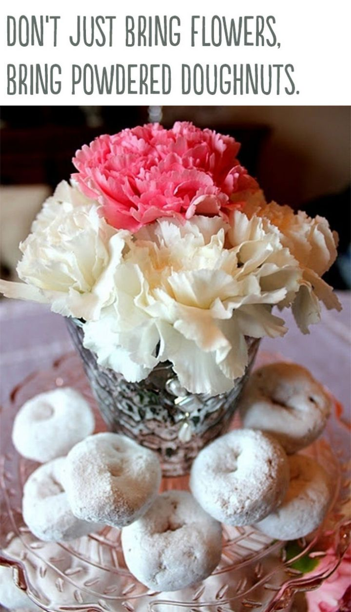 """21 Cute Ways to Say """"I Love You"""" - Don't just bring flowers, bring powdered donuts."""