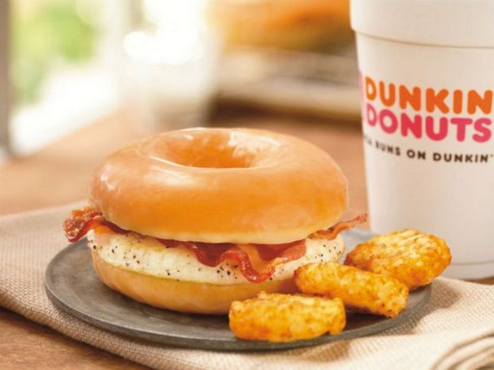 19 Ridiculous But Real Fast Food Items - Dunkin' Donuts Glazed Donut Breakfast Sandwich.