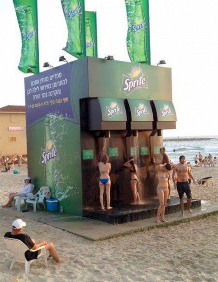 27 Awesome Billboards - Sprite creates a soda fountain machine right on the beach! Unfortunately, you're only being showered with water, not Sprite...