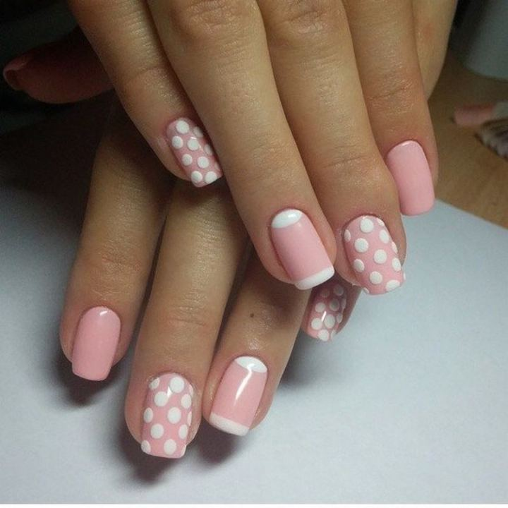 Elegant pink nails that are full of charm.