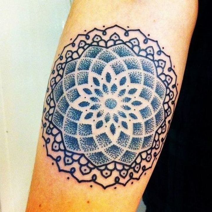 An intriguing blue and black tattoo.