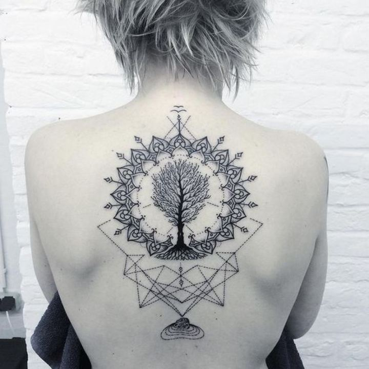A geometric back tattoo featuring a tree.