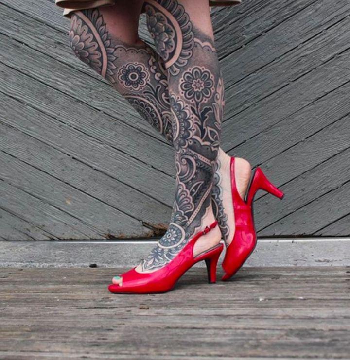 Beautiful artwork with leg mandala tattoos.