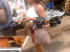 Photo of A Lady Went To The Market Completely Half Naked