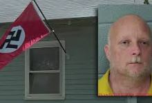 Photo of Oklahoma man arrested after allegedly shooting woman taking Nazi flag from his yard
