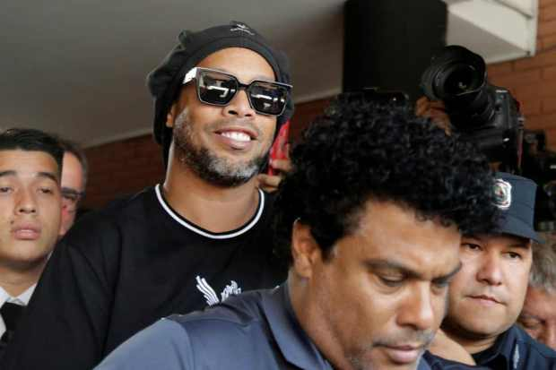 Ronaldinho Released From House Arrest In Paraguay.  Ronaldinho and his brother, Roberto Assis, were jailed in March after entering the country with fake passports.
