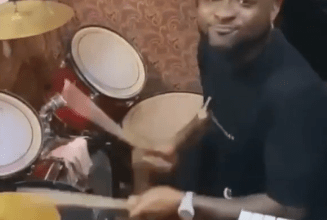 Photo of Davido shows off his drumming skills during a Praise and Worship session in Delta