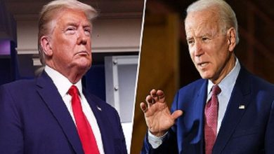 Photo of Trump, Biden go at it – from a distance – in US town hall events.