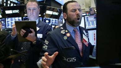 Dow sinks 450 points as stocks fall from records