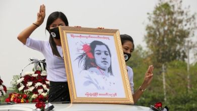 Huge crowds mourn woman killed in protests