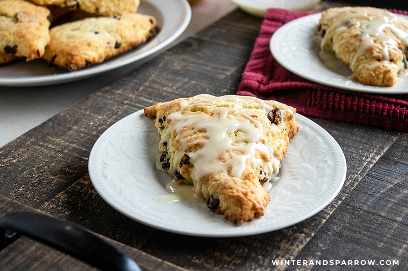 Make these tasty Cranberry Orange Scones for your holiday party, potluck, or lazy weekend at home. You could also give these away as a gifts but I have a feeling you won't want to. Yum! #cranberryorangescones #cranberryorangesconerecipe #cranberrysconerecipe #cranberrysconesrecipe #sconesrecipe #cranberryrecipes