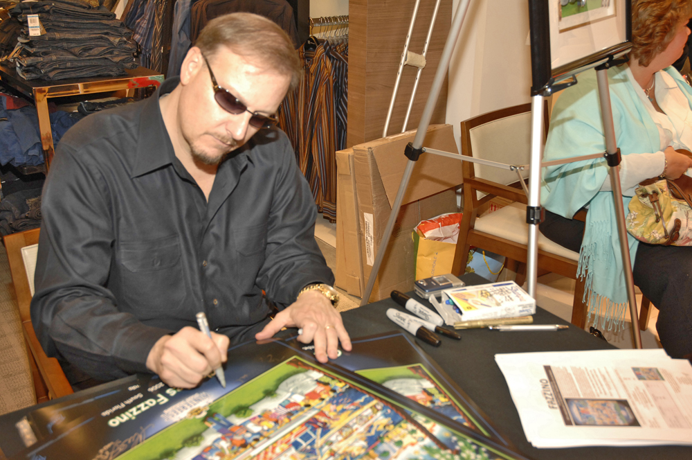 Charles Fazzino signing a past Winterfest Poster
