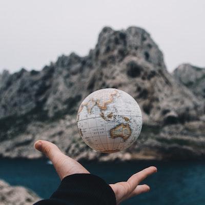 Hand reaching to globe