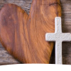 Wooden heart and white cross