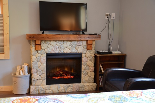 Hotel room with gas fireplace