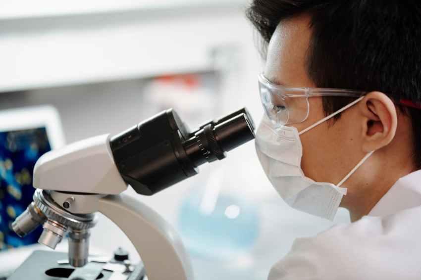 man looking through a microscope