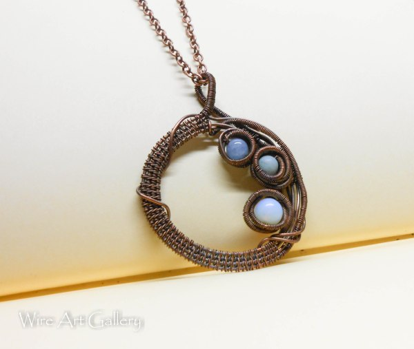 Wire Wrapped Nest Pendant Oxidized Copper. Opalite